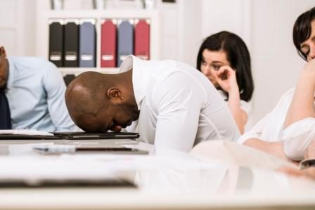 bored man in meeting with his head on the table