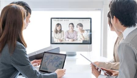 virtual team: staff at desk and on screen