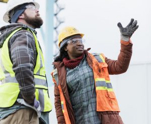 Two construction workers in conversation