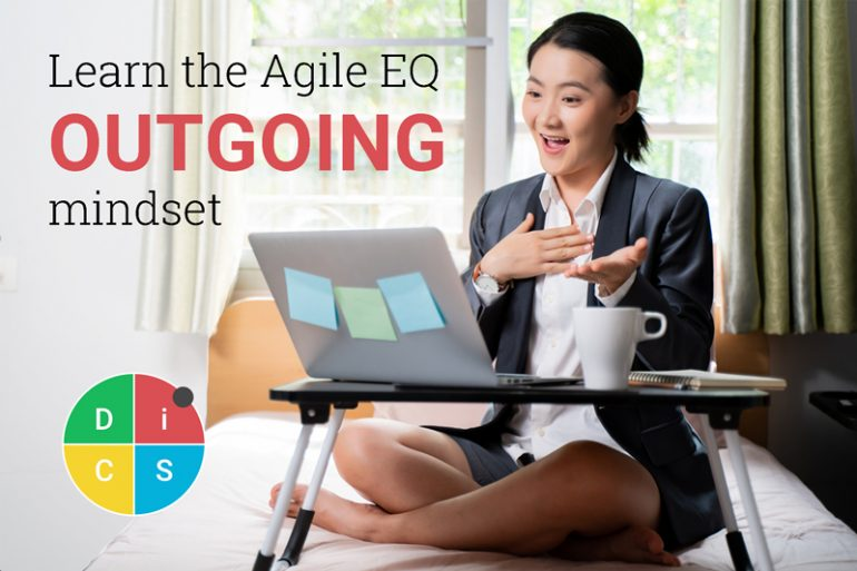 Person talking animatedly on video call with the text Learn the Agile EQ Outgoing mindset