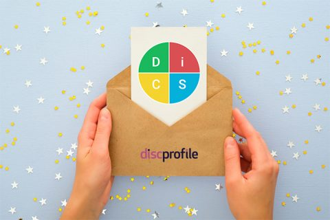Gift envelope opened to show a card with the DiSC graphic